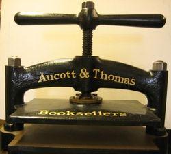 Aucott & Thomas bookstore logo