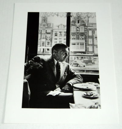 A BEAUTIFUL ORIGINAL PHOTOGRAPH OF CLARK GABLE SEATED AT A RESTAURANT'S WINDOW TABLE, (Gable, Clark). Harris, Martin