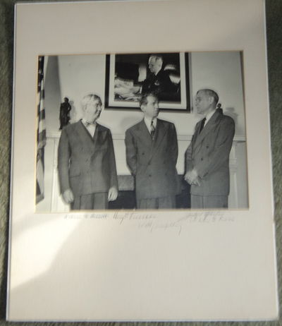 AN ORIGINAL PHOTOGRAPH SIGNED BY PRESIDENT HARRY S. TRUMAN, WILLIAM HASSETT, MATTHEW J. CONNELLY, CHARLES G. ROSS AND THE PIONEERING WOMAN PHOTOGRAPHER JACKIE MARTIN., (Martin, Jackie); (Truman, Harry S.)