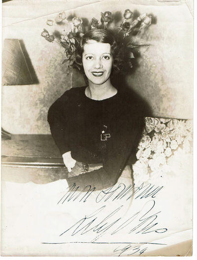 PONS, LILY (1898-1976). FRENCH-AMERICAN OPERATIC SOPRANO AND ACTRESS WHO SPECIALIZED IN COLORATURA SOPRANO ROLES. - An Original Photograph of the French-American Soprano Lily Pons, Signed by Her.