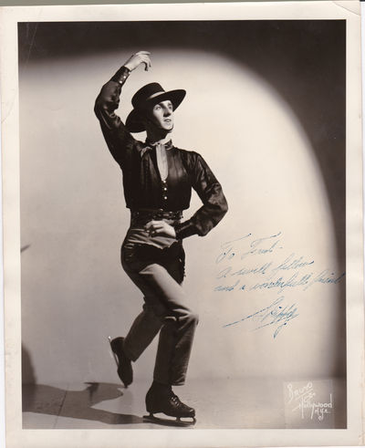 BRUNO OF HOLLYWOOD PUBLICITY PHOTO INSCRIBED AND SIGNED BY SKIPPY  BAXTER., Baxter, Lloyd Valdemar (Skippy). (1919-2012). American figure skater, the first to land the triple Salchow in 1939.