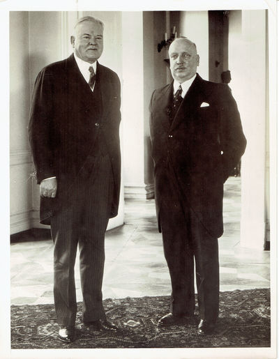A WONDERFUL VINTAGE 1939 NEWS PHOTOGRAPH DEPICTING FORMER U.S. PRESIDENT HERBERT HOOVER WITH AUSTRIAN PRESIDENT WILHELM MIKLAS DURING THE PERIOD WHICH PRECEDED THE SECOND WORLD WAR, (Hoover, President Herbert.; and Miklas, Wilhelm)