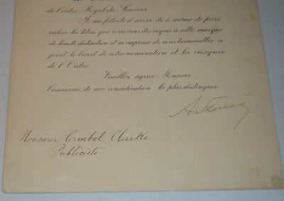 A PARTIALLY PRINTED DOCUMENT SIGNED BY MINISTER FOR FOREIGN AFFAIRS ALEXANDROS SKOUZES CONFERRING, ON BEHALF OF THE KING, THE CROSS OF THE COMMANDER OF THE ROYAL ORDER OF THE REDEEMER ON BRITISH JOURNALIST CAMPBELL CLARKE., (Clarke, Campbell). Skouzes, Alexandros. (1853-1937). Greek politician who served several times as Minister for Foreign Affairs of the Kingdom of Greece.